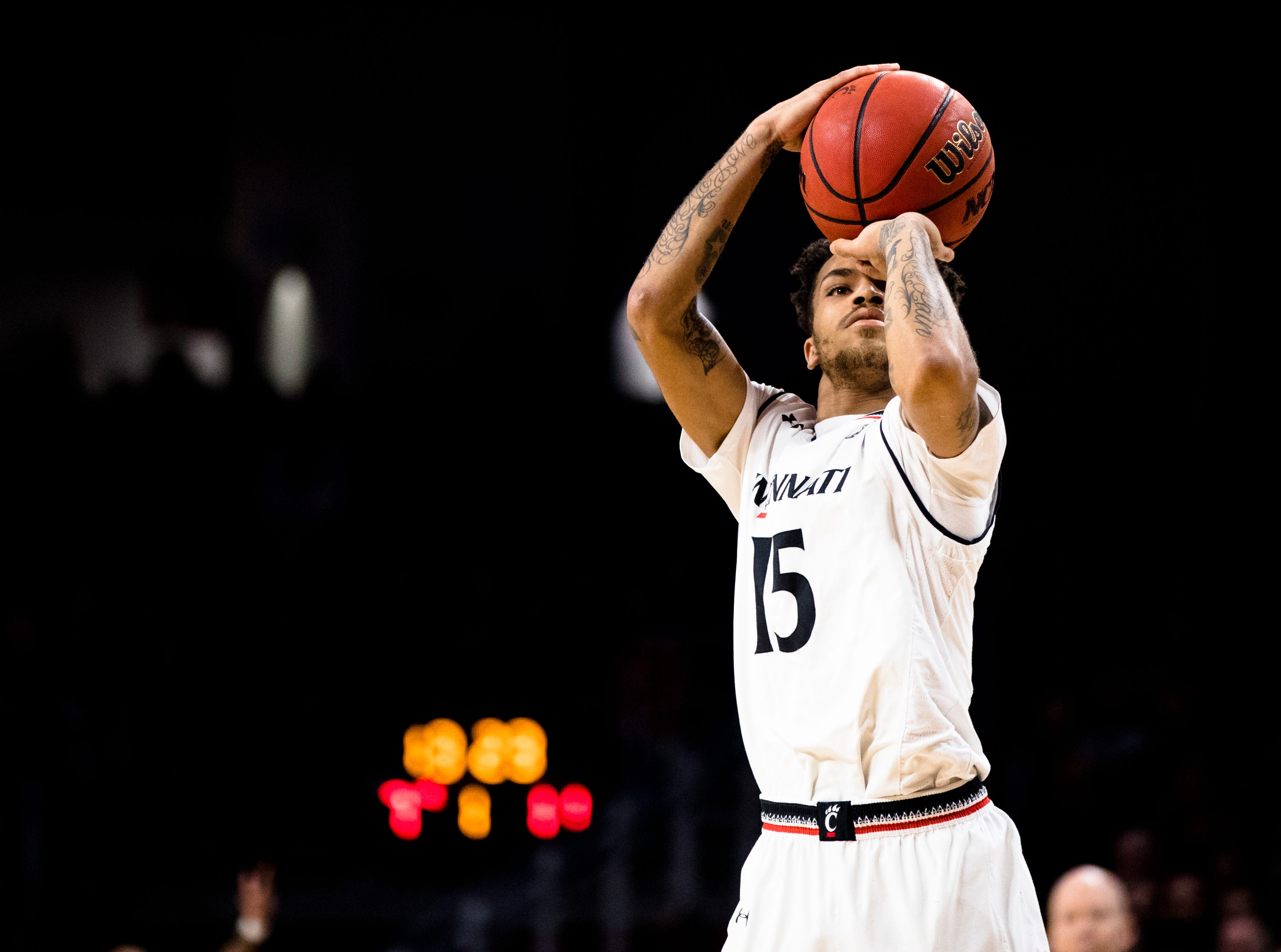 Cincinnati Bearcats guard Cane Broome (15) shoots a 3-pointer in the first half of the NCAA men's basketball game between Cincinnati Bearcats and UCF Knights on Thursday, Feb. 21, 2019, at Fifth Third Arena in Cincinnati.