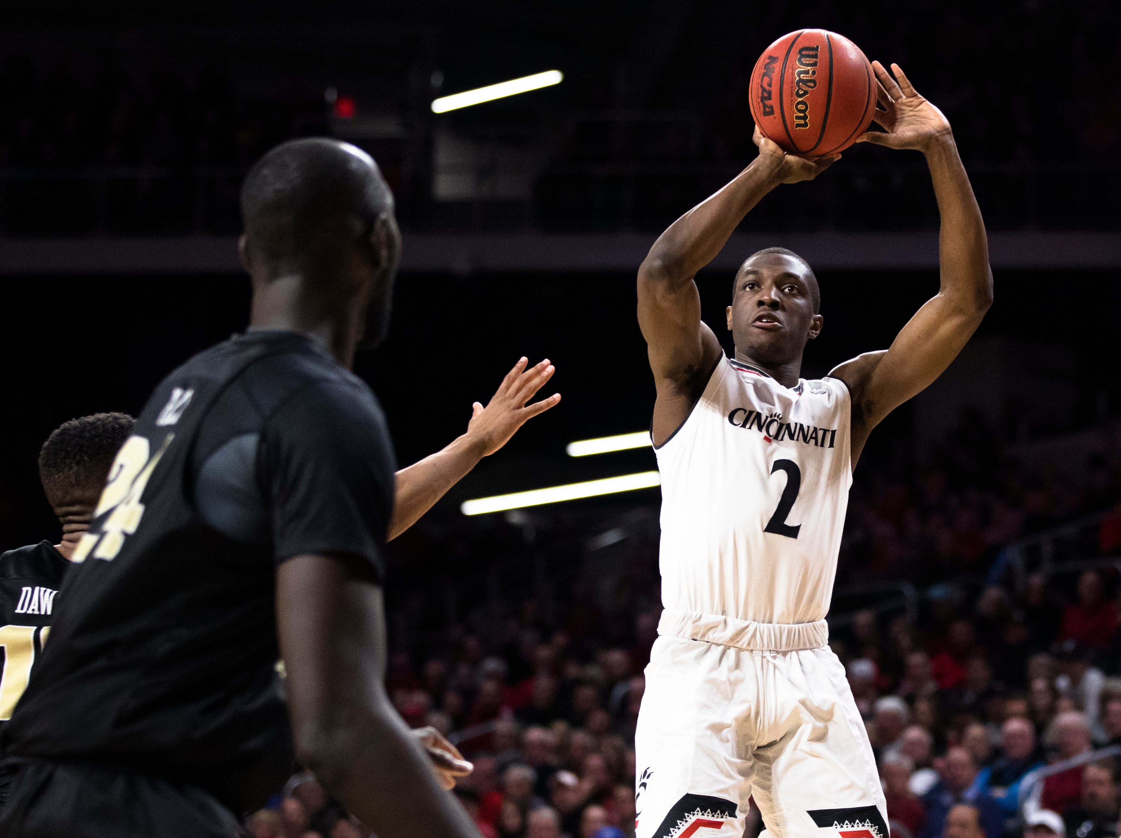 Cincinnati Bearcats guard Keith Williams (2) shoots as UCF Knights guard Dayon Griffin (10) in the first half of the NCAA men's basketball game between Cincinnati Bearcats and UCF Knights on Thursday, Feb. 21, 2019, at Fifth Third Arena in Cincinnati.