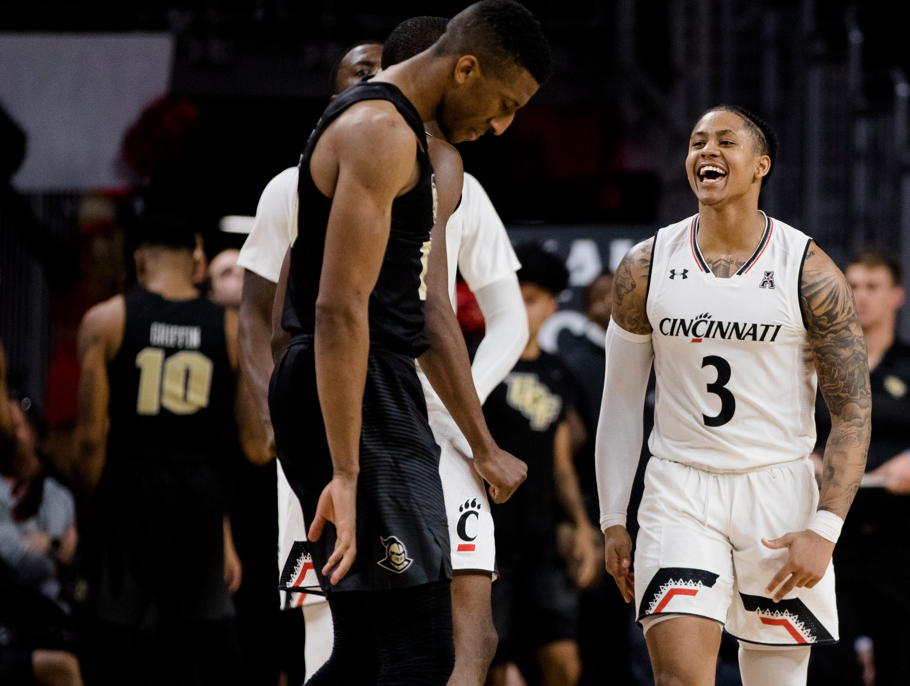 Cincinnati Bearcats guard Justin Jenifer (3) celebrates after hitting a 3-pointer in the second half of the NCAA men's basketball game between Cincinnati Bearcats and UCF Knights on Thursday, Feb. 21, 2019, at Fifth Third Arena in Cincinnati.