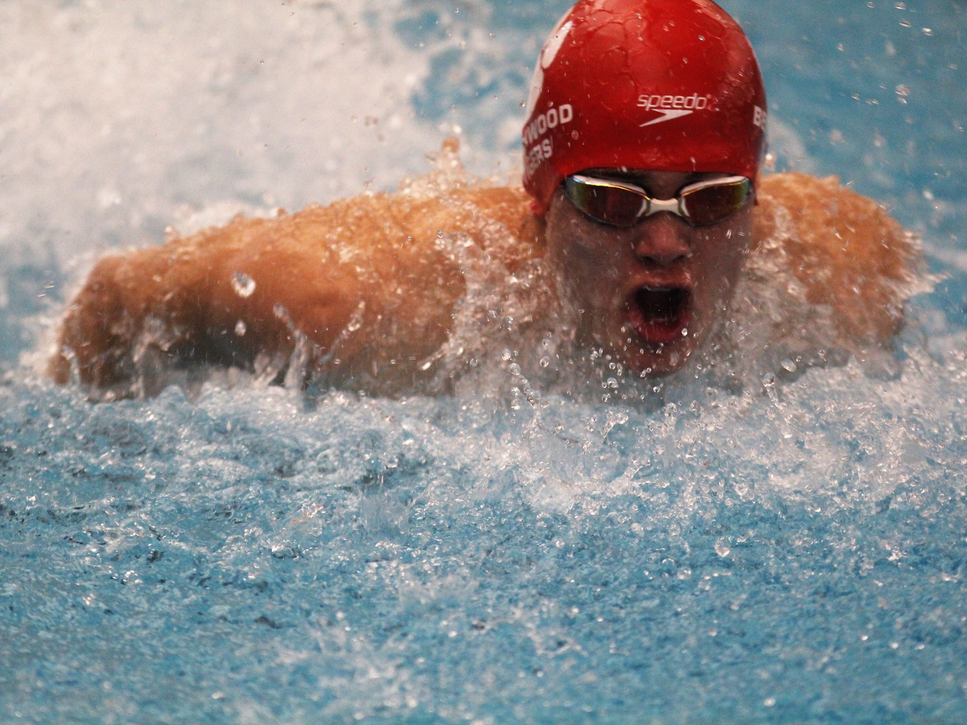 Beechwood junior Tristen Richards swims the 100 butterfly during the KHSAA boys state swimming and diving championships Feb. 22, 2019 at the University of Louisville.