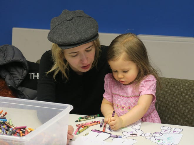 Annette and Madeline Mayers, 2, of Watchung, create colorful valentines at the library.