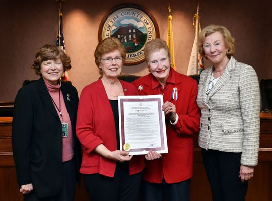 Union County Freeholder Chair Bette Jane Kowalski presents a resolution to Mary Leonard, president of the Crane's Ford Chapter of the Daughters of the American Revolution, past president Barbara Krause and chapter member Union County Clerk Joanne Rajoppi congratulating the chapter on its 75th anniversary. The Daughters of the American Revolution is a volunteer women's service organization. Membership is open to any women 18 years and older who can prove lineal bloodline descent from an ancestor who aided in achieving American independence.