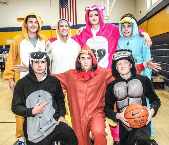 Ready for Hoops for Heart or a pajama party are (clockwise from back left) Brett Levy, John Raymond, Jack Skibinski, Brandon Bishop, Brett Godown, Vinne Giordano and Andrew Panfile.