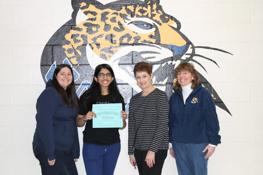 SCVTHS Supervisor of Academics Randee Holz, SCVTHS student Veda Kota, SCVTHS Supervisor of Academics Teresa Morelli and SCVTHS Guidance Counselor Maureen Lawler pose for a picture after presenting Veda with her certificate at Somerset County Vocational & Technical High School.