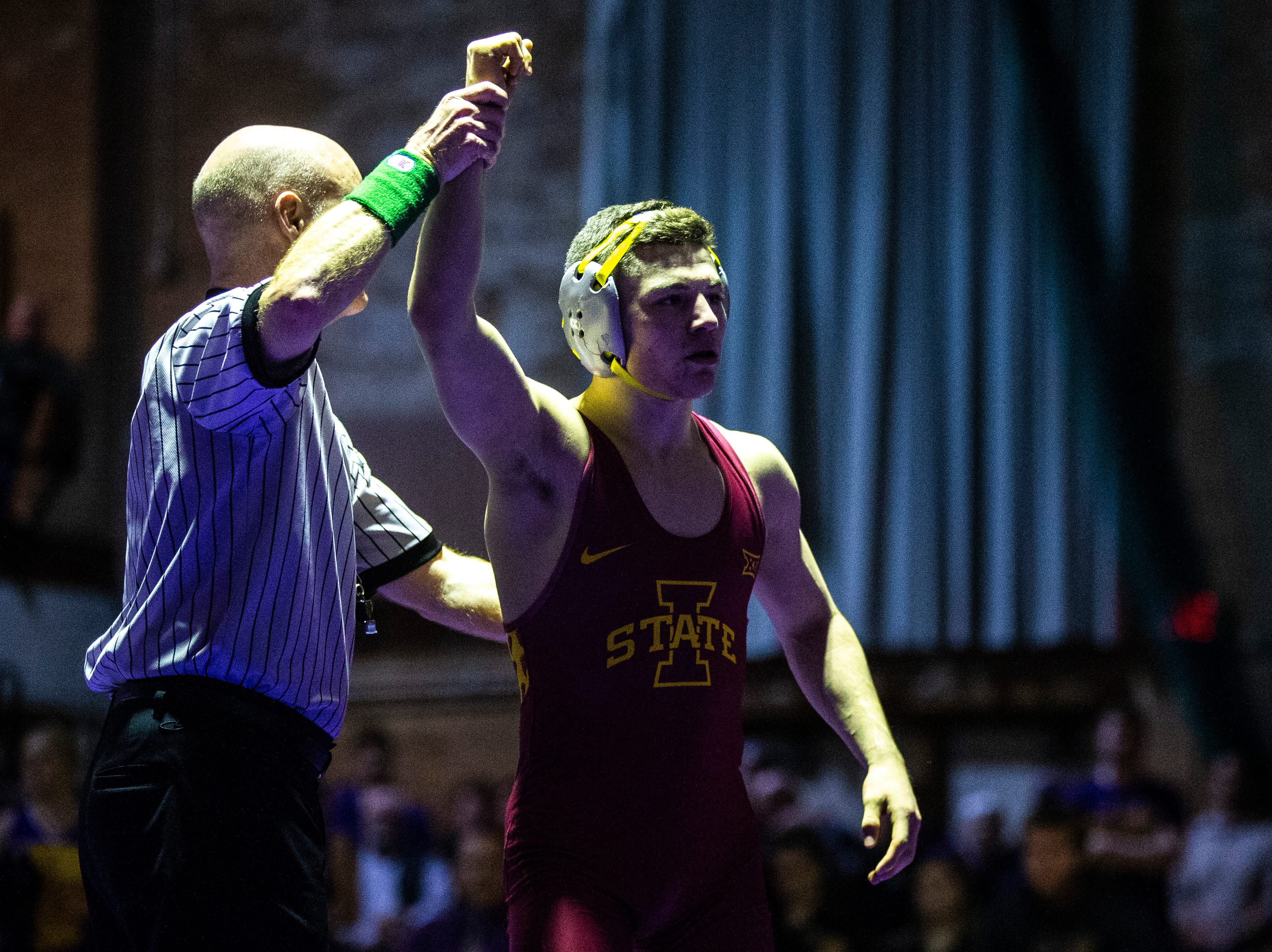 Iowa State's Austin Gomez has his hand raised after winning a match at 133 during a NCAA Big 12 wrestling dual on Thursday, Feb. 21, 2019 at the West Gymnasium in Cedar Falls, Iowa.