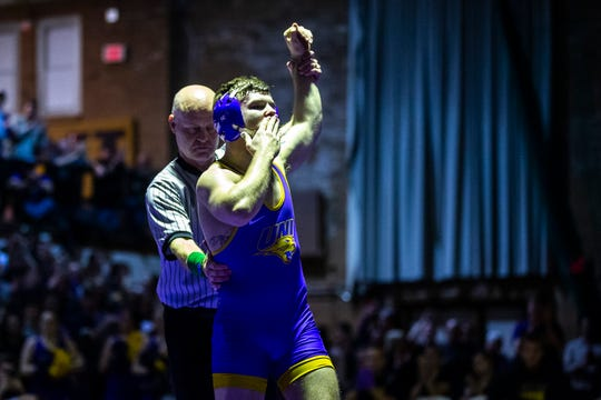 Northern Iowa's Josh Alber blows a kiss to the crowd while having his hand raised after wrestling Iowa State's Ian Parker at 141 during a NCAA Big 12 wrestling dual on Thursday, Feb. 21, 2019 at the West Gymnasium in Cedar Falls, Iowa.