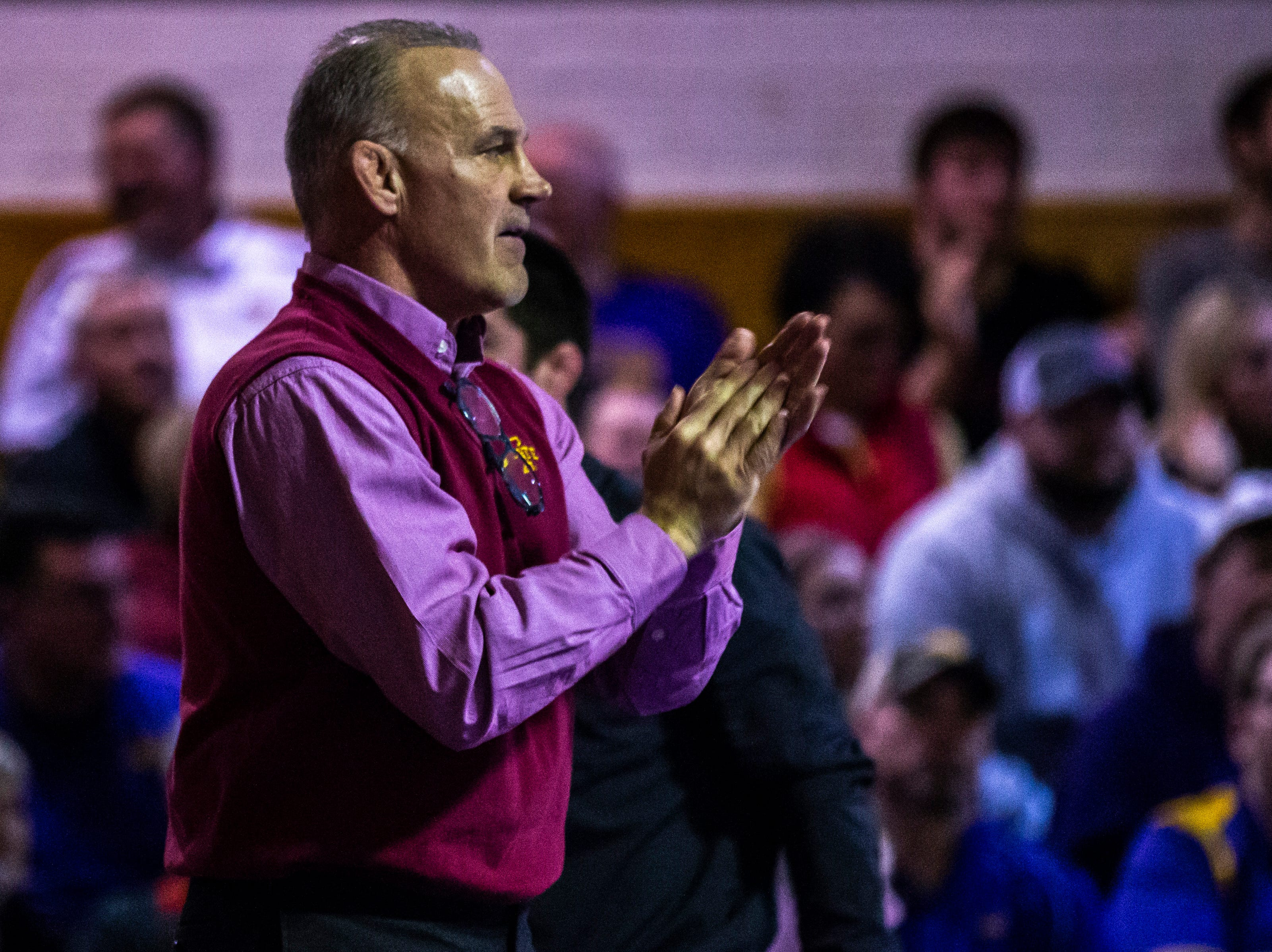Iowa State head coach Kevin Dresser claps during a NCAA Big 12 wrestling dual on Thursday, Feb. 21, 2019 at the West Gymnasium in Cedar Falls, Iowa.