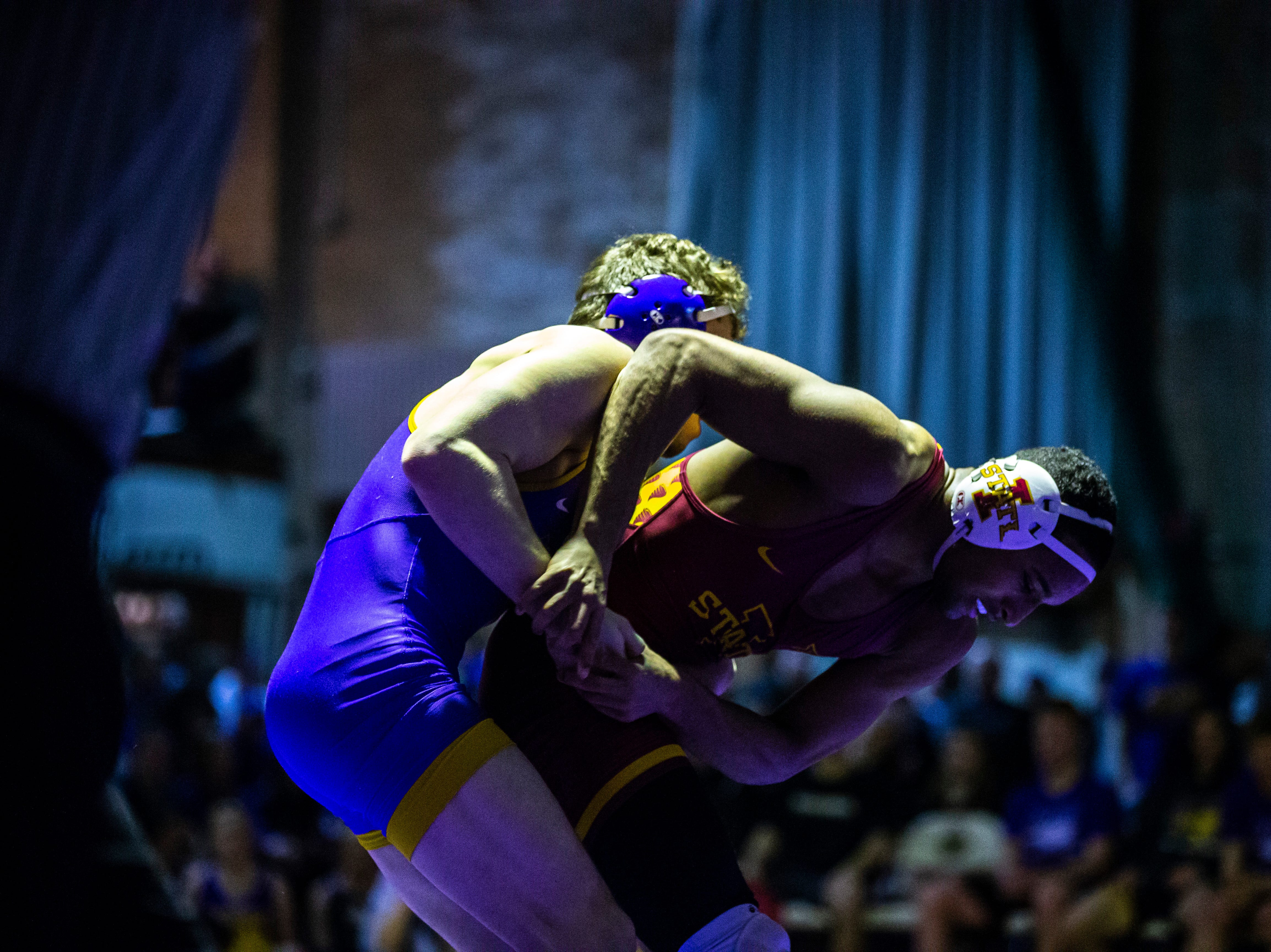 Northern Iowa's Taylor Lujan wrestles Iowa State's Marcus Coleman wrestles at 174 during a NCAA Big 12 wrestling dual on Thursday, Feb. 21, 2019 at the West Gymnasium in Cedar Falls, Iowa.