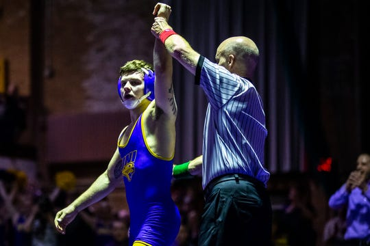 Northern Iowa's Josh Alber has his hand raised after wrestling Iowa State's Ian Parker at 141 during a NCAA Big 12 wrestling dual on Thursday, Feb. 21, 2019 at the West Gymnasium in Cedar Falls, Iowa.