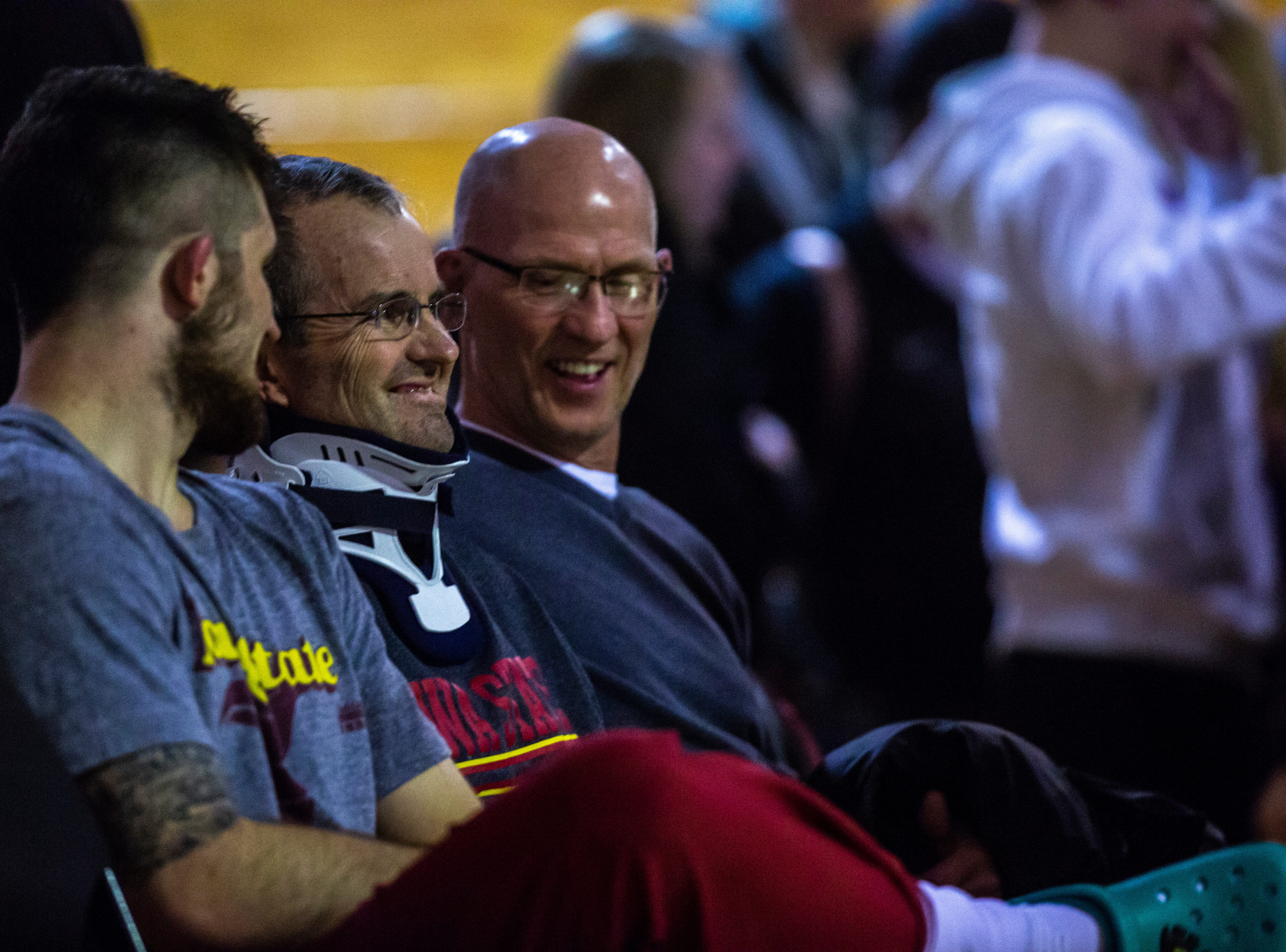 Iowa State's Willie Miklus sits with his father Garry after a NCAA Big 12 wrestling dual against Northern Iowa on Thursday, Feb. 21, 2019 at the West Gymnasium in Cedar Falls, Iowa.