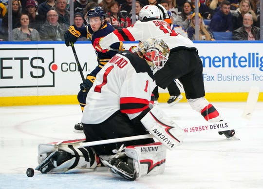 Buffalo Sabres left wing C.J. Smith (49) scores his first NHL goal against New Jersey Devils goaltender Keith Kinkaid (1) during the second period Jan. 8 at KeyBank Center