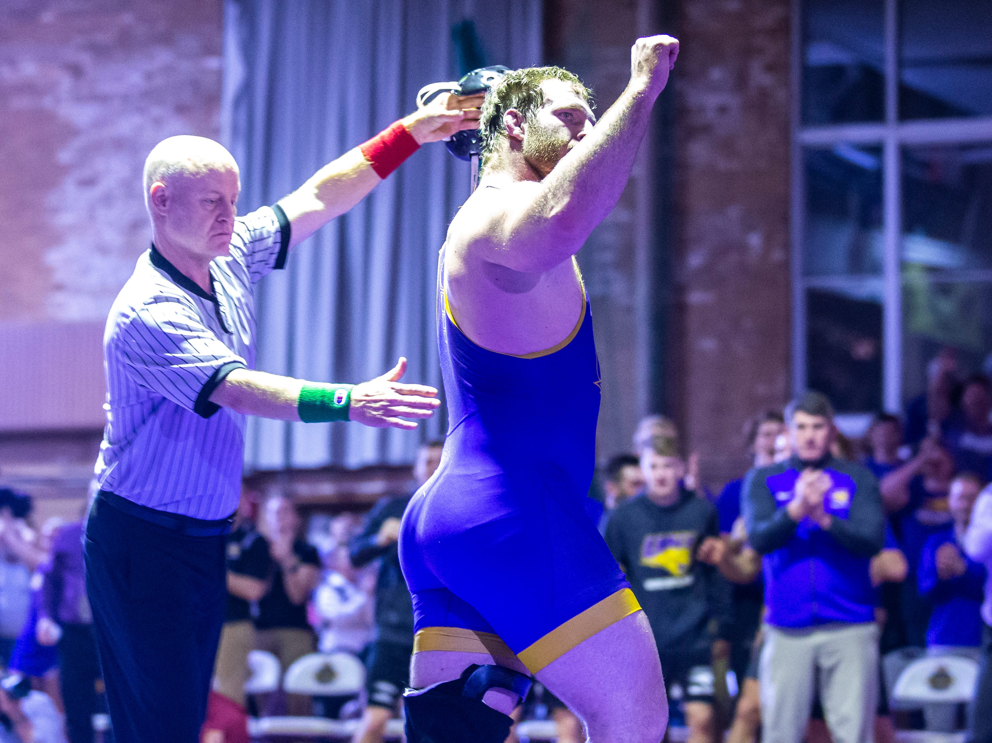 Northern Iowa's Carter Isley celebrates after scoring a takedown on Iowa State's Gannon Gremmel at 285 during a NCAA Big 12 wrestling dual on Thursday, Feb. 21, 2019 at the West Gymnasium in Cedar Falls, Iowa.