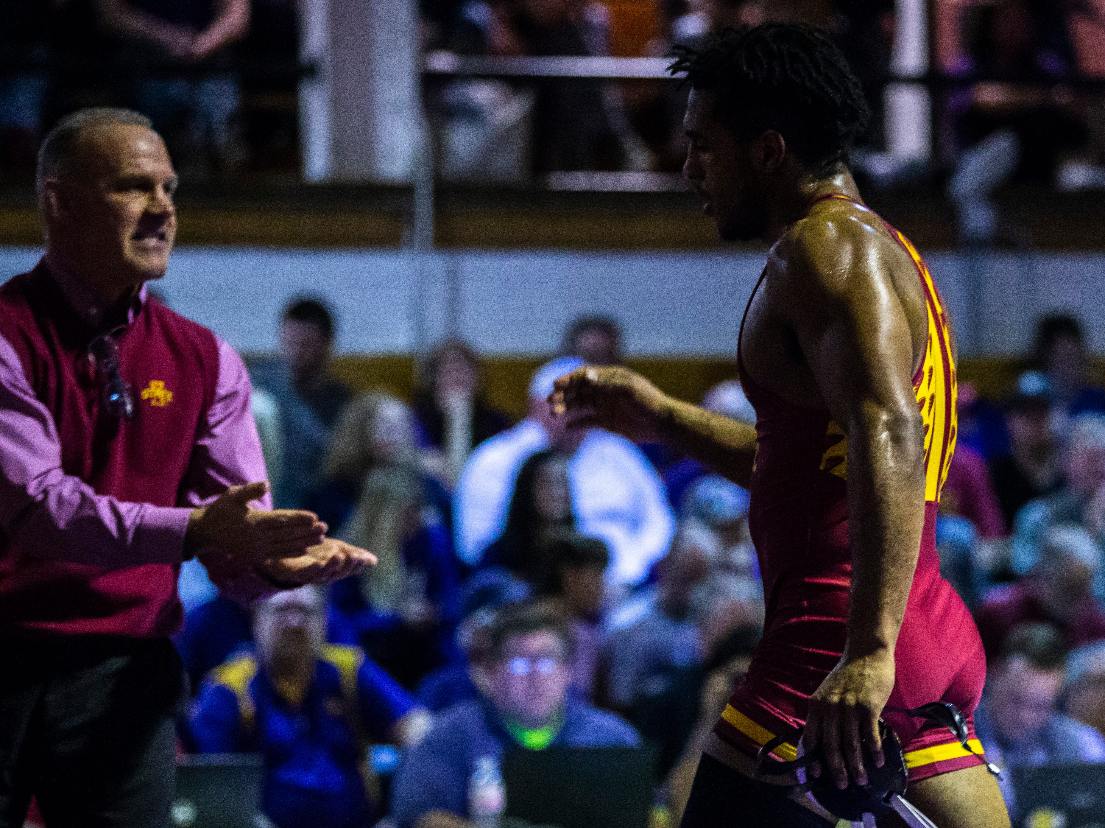 Iowa State's Sam Colbray gets a high-five from head coach Kevin Dresser, left, after scoring a decision over Northern Iowa's Drew Foster at 184 during a NCAA Big 12 wrestling dual on Thursday, Feb. 21, 2019 at the West Gymnasium in Cedar Falls, Iowa.