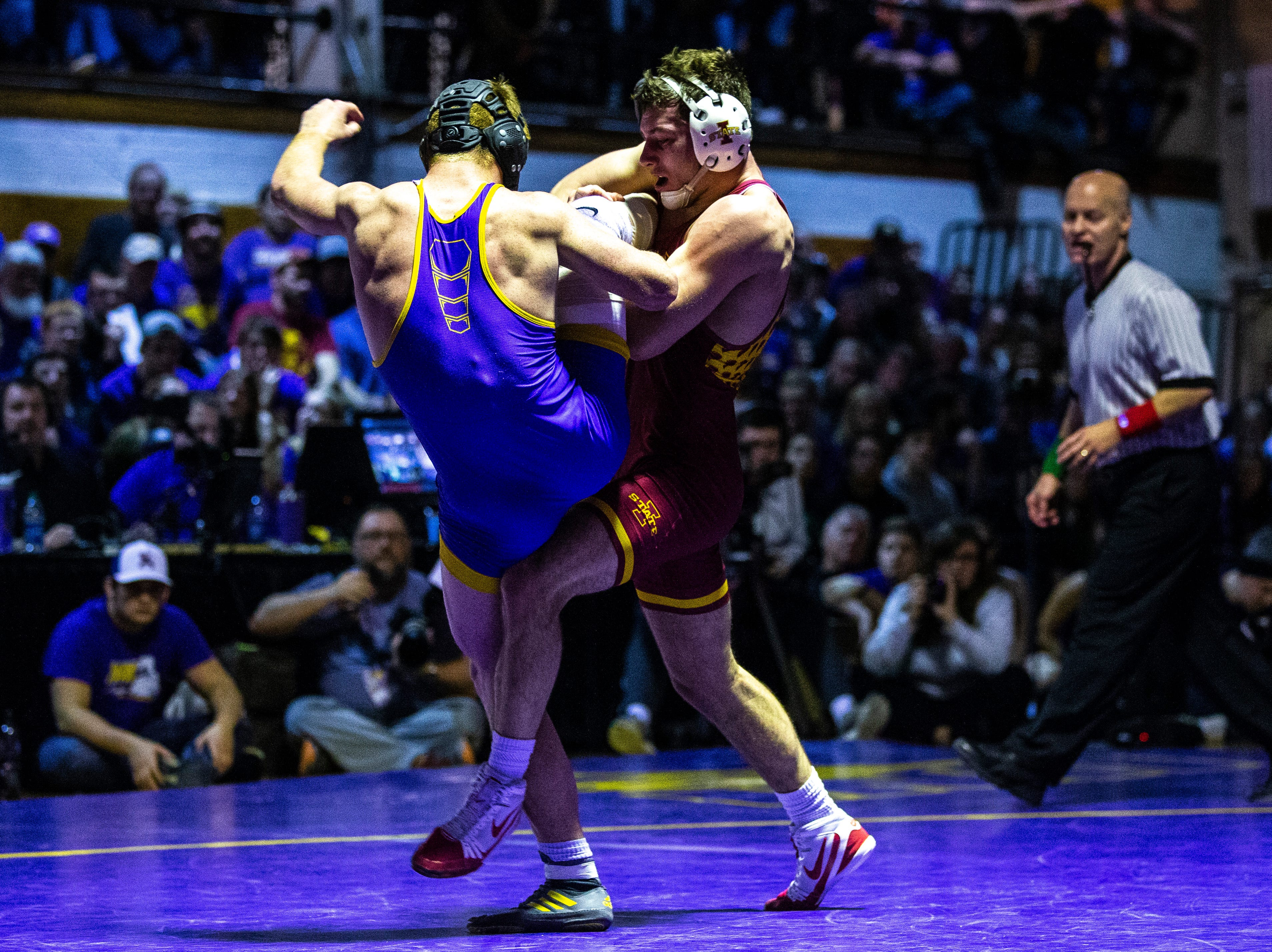 Northern Iowa's Paden Moore wrestles Iowa State's Chase Straw at 157 during a NCAA Big 12 wrestling dual on Thursday, Feb. 21, 2019 at the West Gymnasium in Cedar Falls, Iowa.