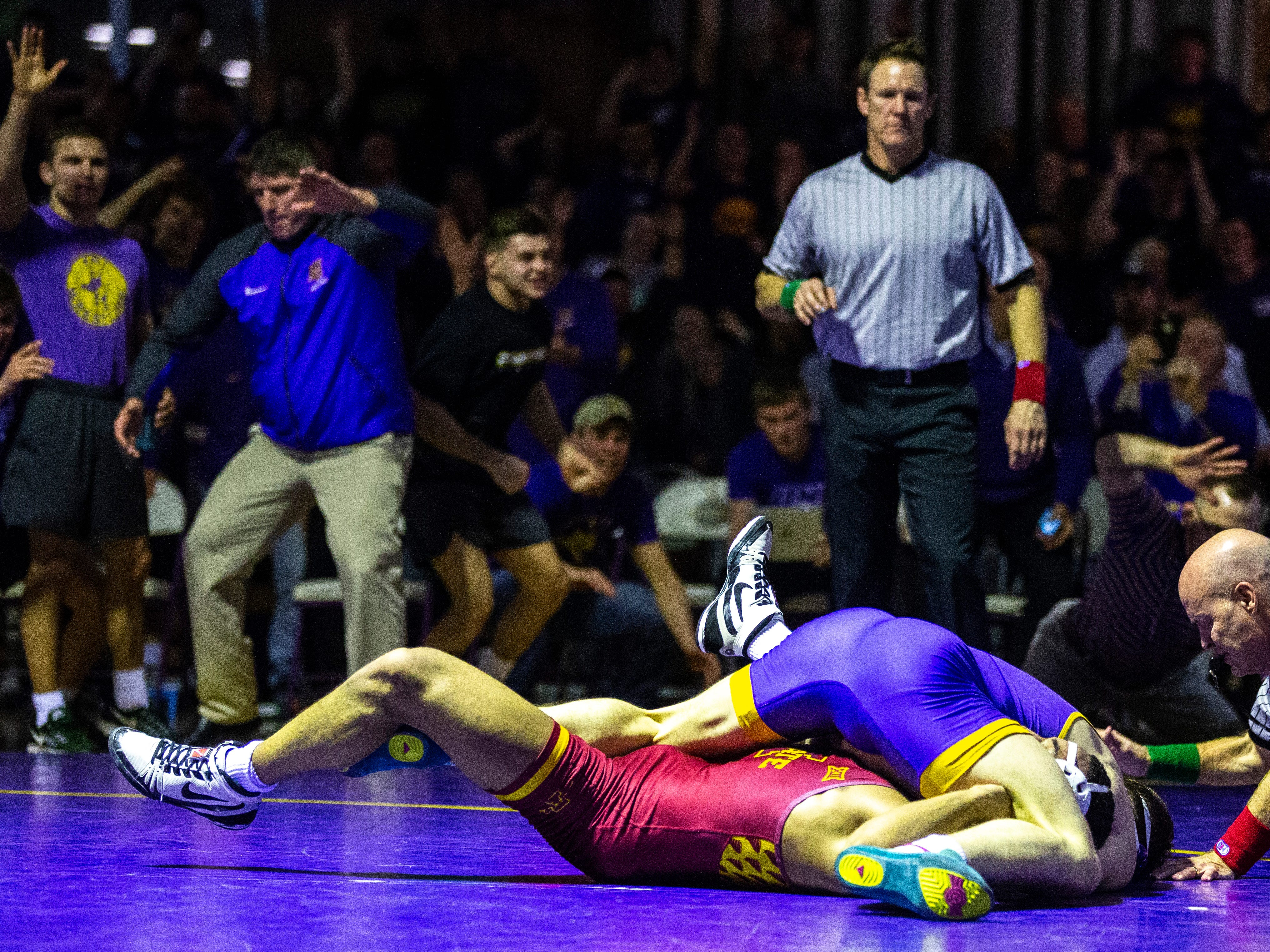 Northern Iowa's Taylor Lujan pins Iowa State's Marcus Coleman wrestles at 174 during a NCAA Big 12 wrestling dual on Thursday, Feb. 21, 2019 at the West Gymnasium in Cedar Falls, Iowa.