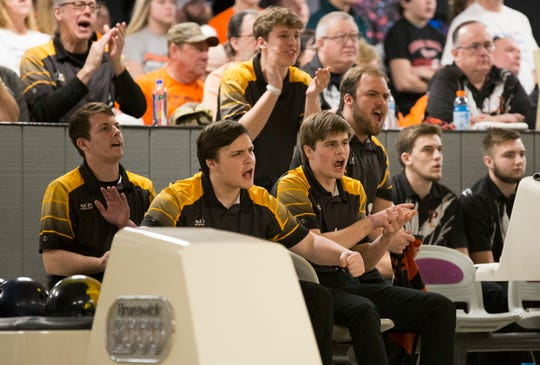 Southeast Polk bowlers cheer on their teammate during the state bowling competition at Cadillac Lanes in Waterloo, Iowa, on Thursday, Feb. 21, 2019.