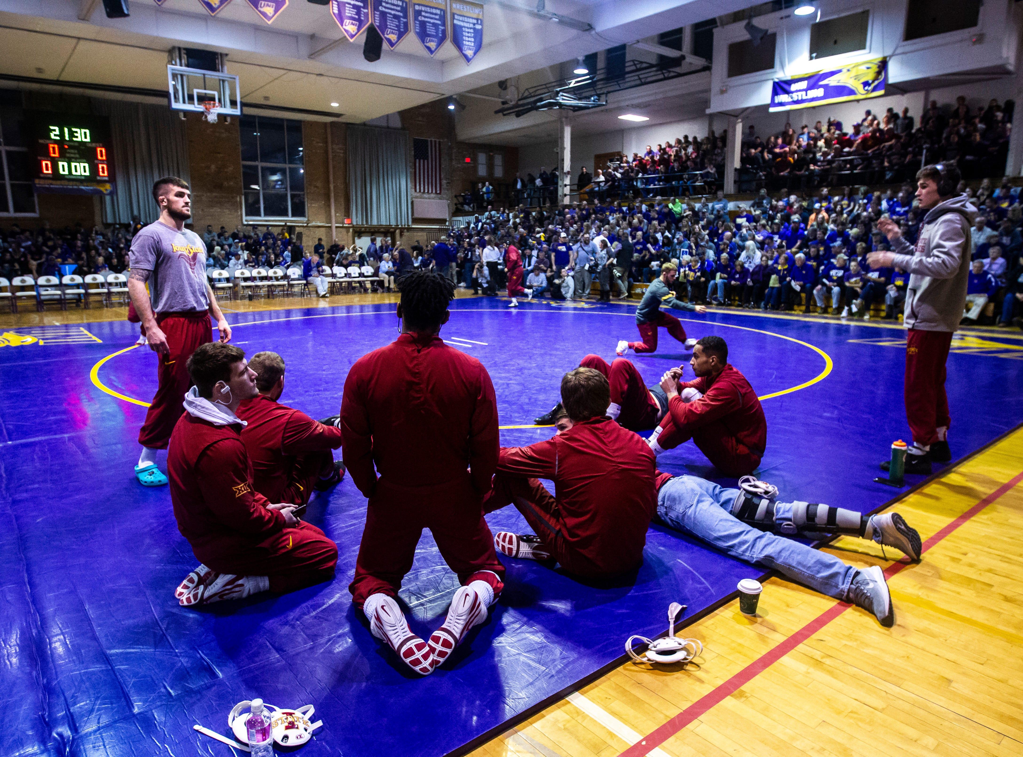 Iowa State senior Willie Miklus talks with teammates before a NCAA Big 12 wrestling dual on Thursday, Feb. 21, 2019 at the West Gymnasium in Cedar Falls, Iowa.