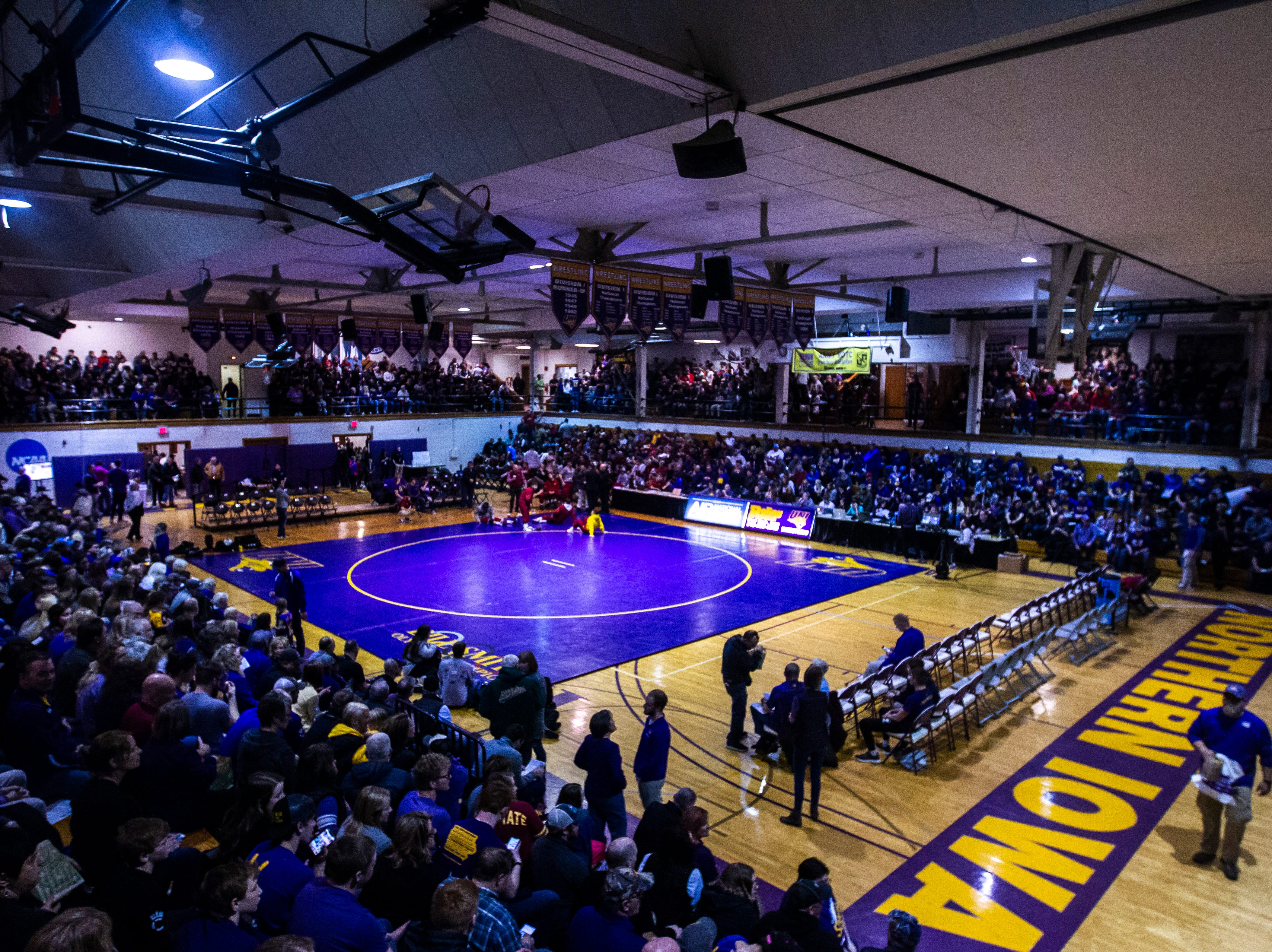 Fans get settled before a NCAA Big 12 wrestling dual on Thursday, Feb. 21, 2019 at the West Gymnasium in Cedar Falls, Iowa.