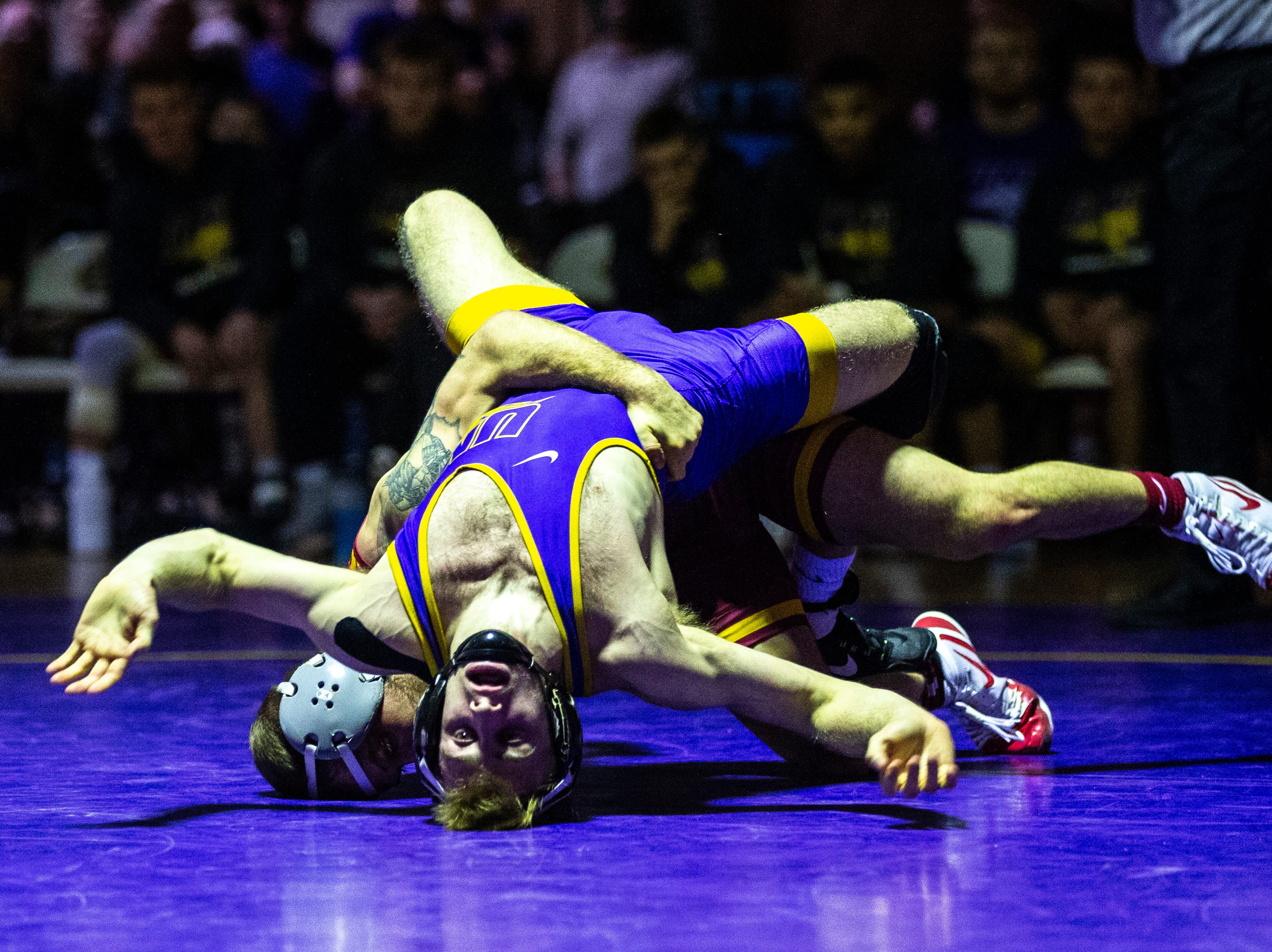 Northern Iowa's Jay Schwarm wrestles Iowa State's Alex Mackall at 125 during a NCAA Big 12 wrestling dual on Thursday, Feb. 21, 2019 at the West Gymnasium in Cedar Falls, Iowa.