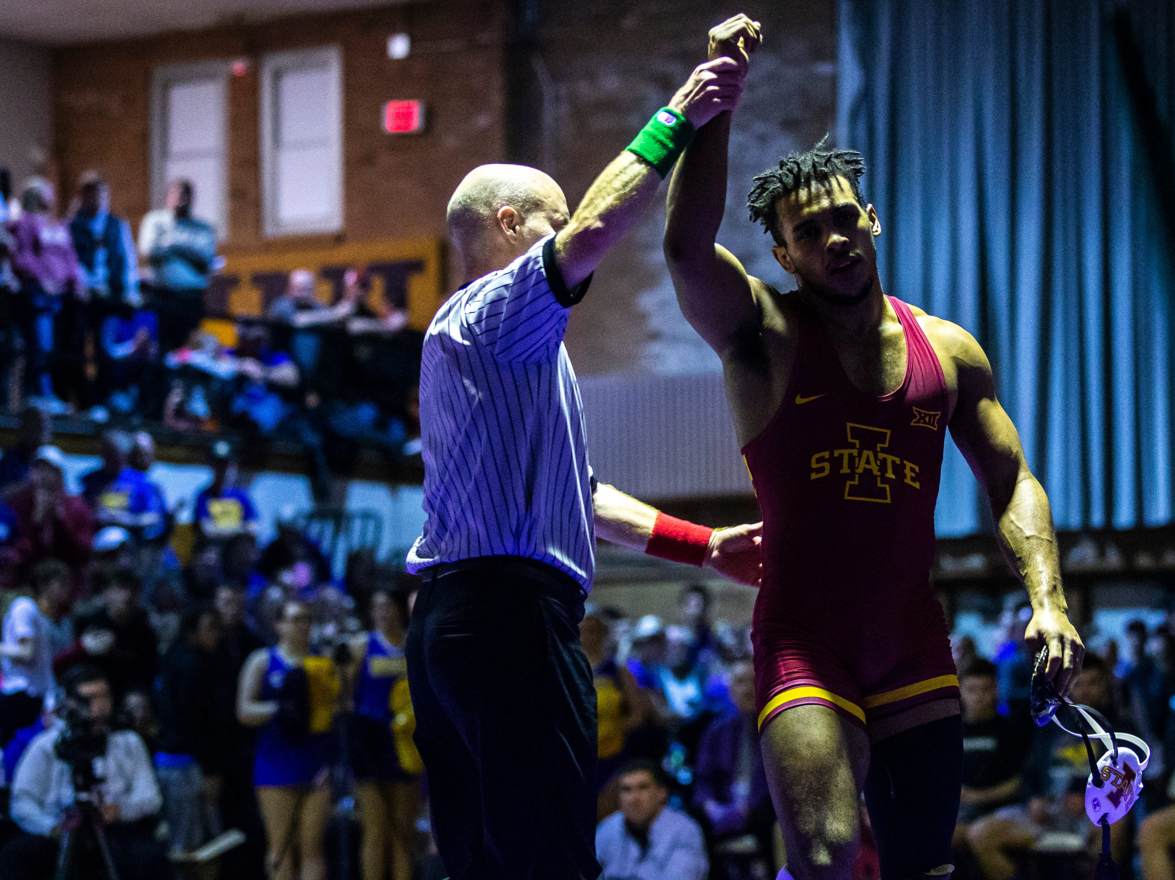 Iowa State's Sam Colbray has his hand raised after scoring a decision over Northern Iowa's Drew Foster at 184 during a NCAA Big 12 wrestling dual on Thursday, Feb. 21, 2019 at the West Gymnasium in Cedar Falls, Iowa.