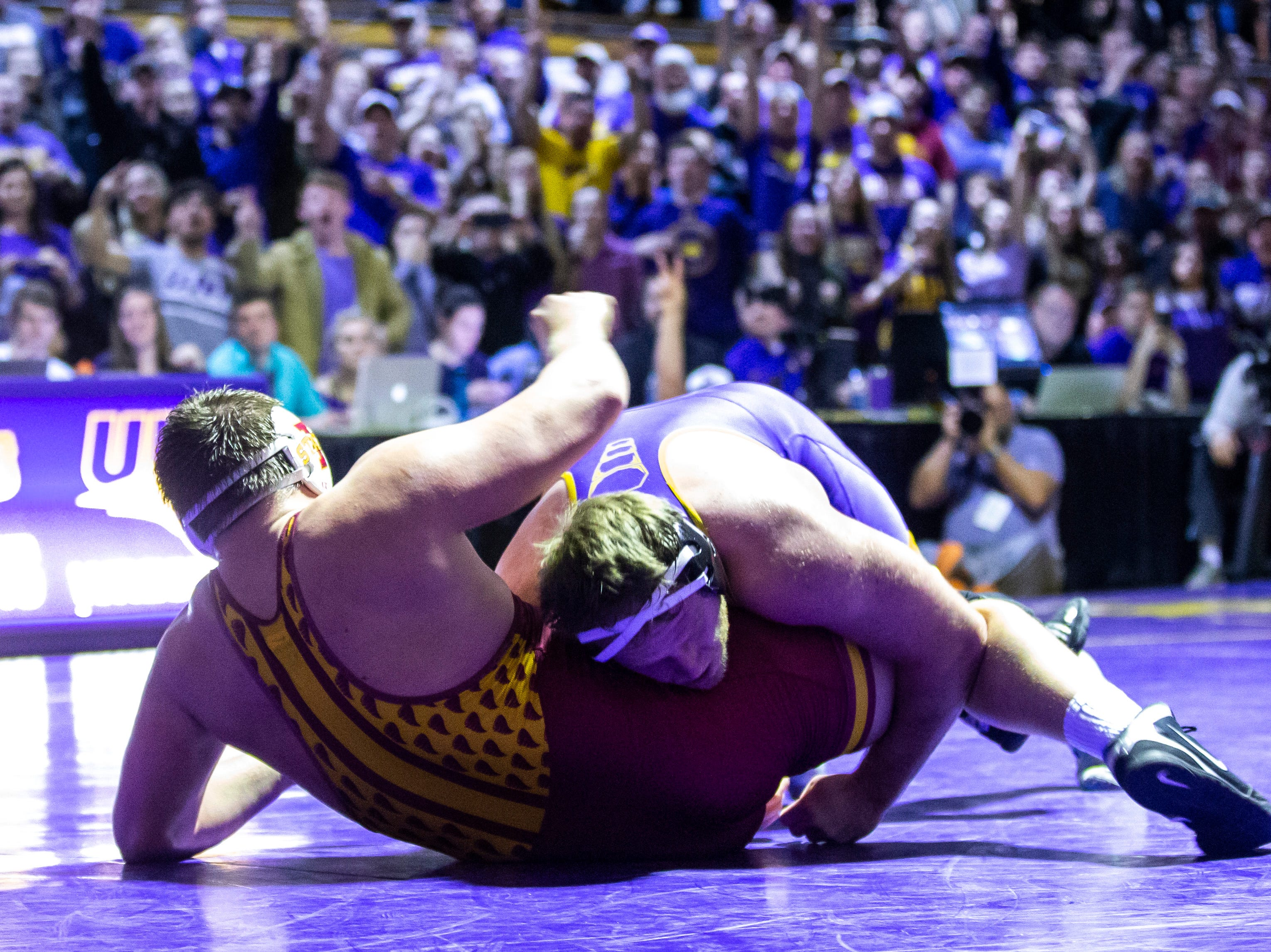 Northern Iowa's Carter Isley scores a takedown on Iowa State's Gannon Gremmel at 285 during a NCAA Big 12 wrestling dual on Thursday, Feb. 21, 2019 at the West Gymnasium in Cedar Falls, Iowa.