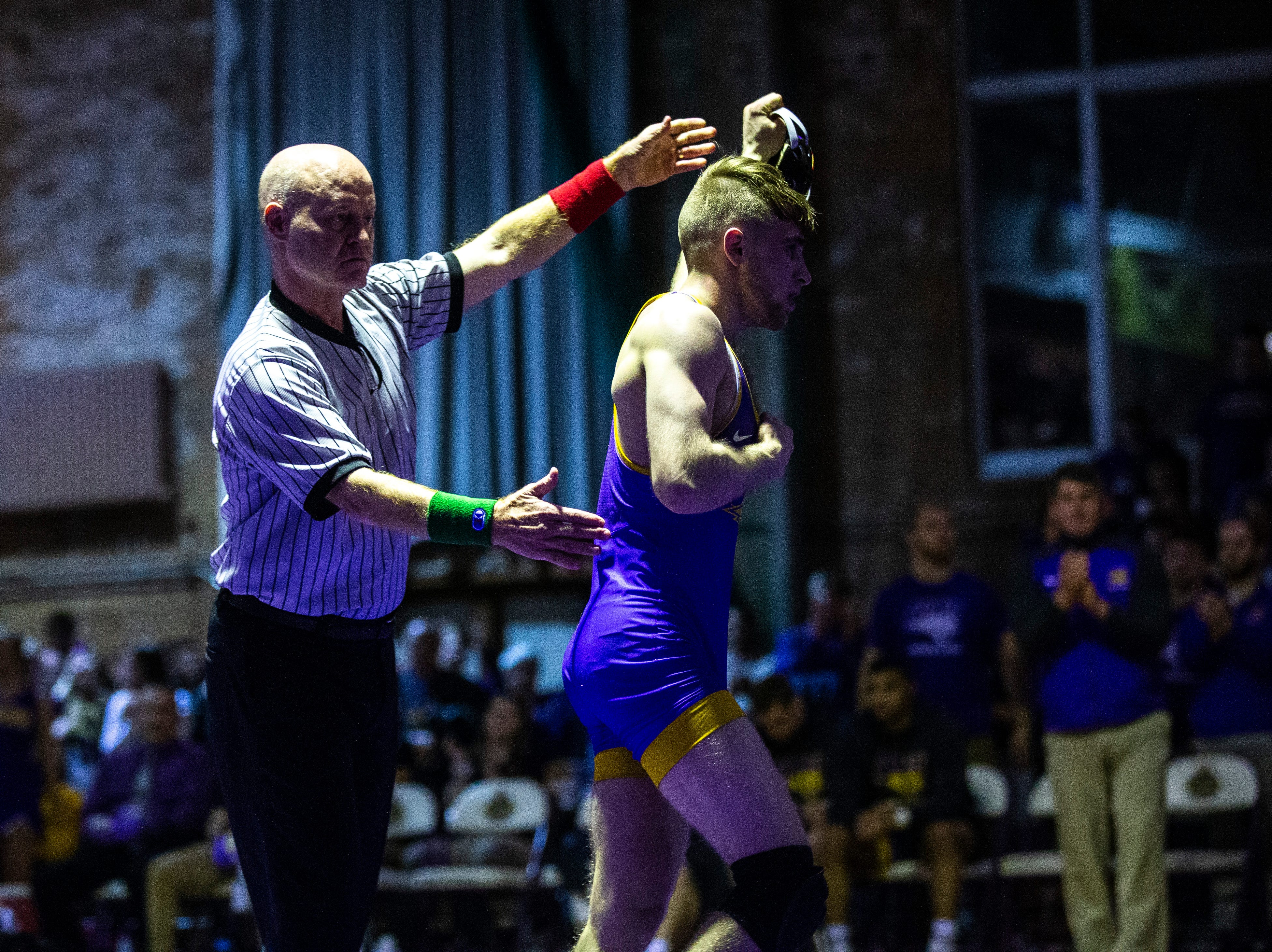 Northern Iowa's Jay Schwarm has his hand raised after wrestling Iowa State's Alex Mackall at 125 during a NCAA Big 12 wrestling dual on Thursday, Feb. 21, 2019 at the West Gymnasium in Cedar Falls, Iowa.