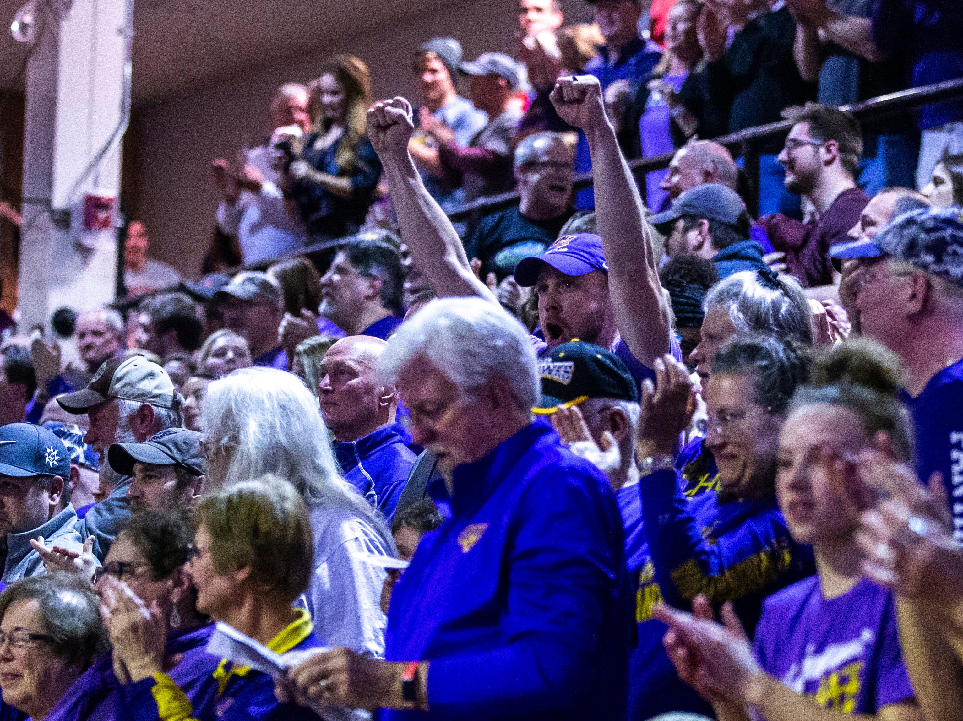Northern Iowa fans cheer during a NCAA Big 12 wrestling dual on Thursday, Feb. 21, 2019 at the West Gymnasium in Cedar Falls, Iowa.