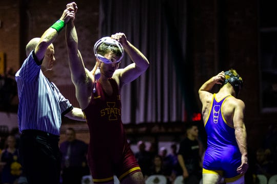 Iowa State's Chase Straw has his hand rasied after scoring a decision at 157 over Northern Iowa's Paden Moore during a NCAA Big 12 wrestling dual on Thursday, Feb. 21, 2019, at the West Gymnasium in Cedar Falls, Iowa.