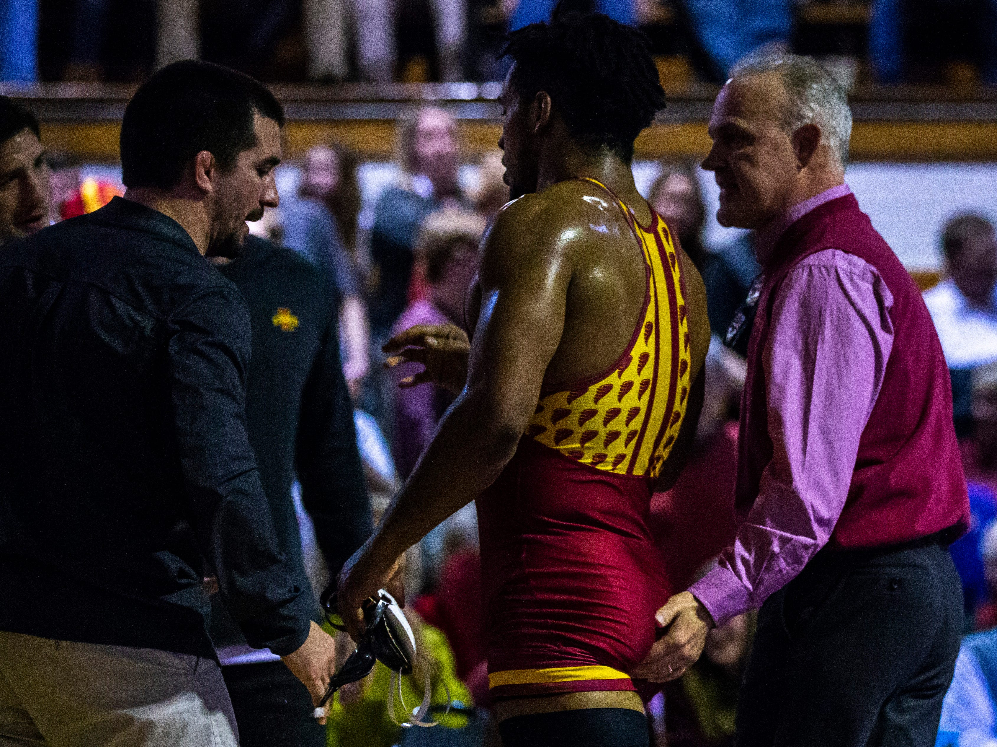 Iowa State's Sam Colbray gets embraced by coaches Kevin Dresser, Derek St. John and Brent Metcalf after scoring a decision over Northern Iowa's Drew Foster at 184 during a NCAA Big 12 wrestling dual on Thursday, Feb. 21, 2019 at the West Gymnasium in Cedar Falls, Iowa.