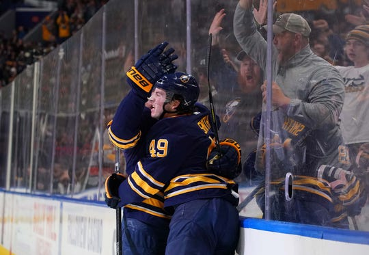 Buffalo Sabres left wing C.J. Smith (49) celebrates after he scores his first NHL goal against the New Jersey Devils on Jan. 8.