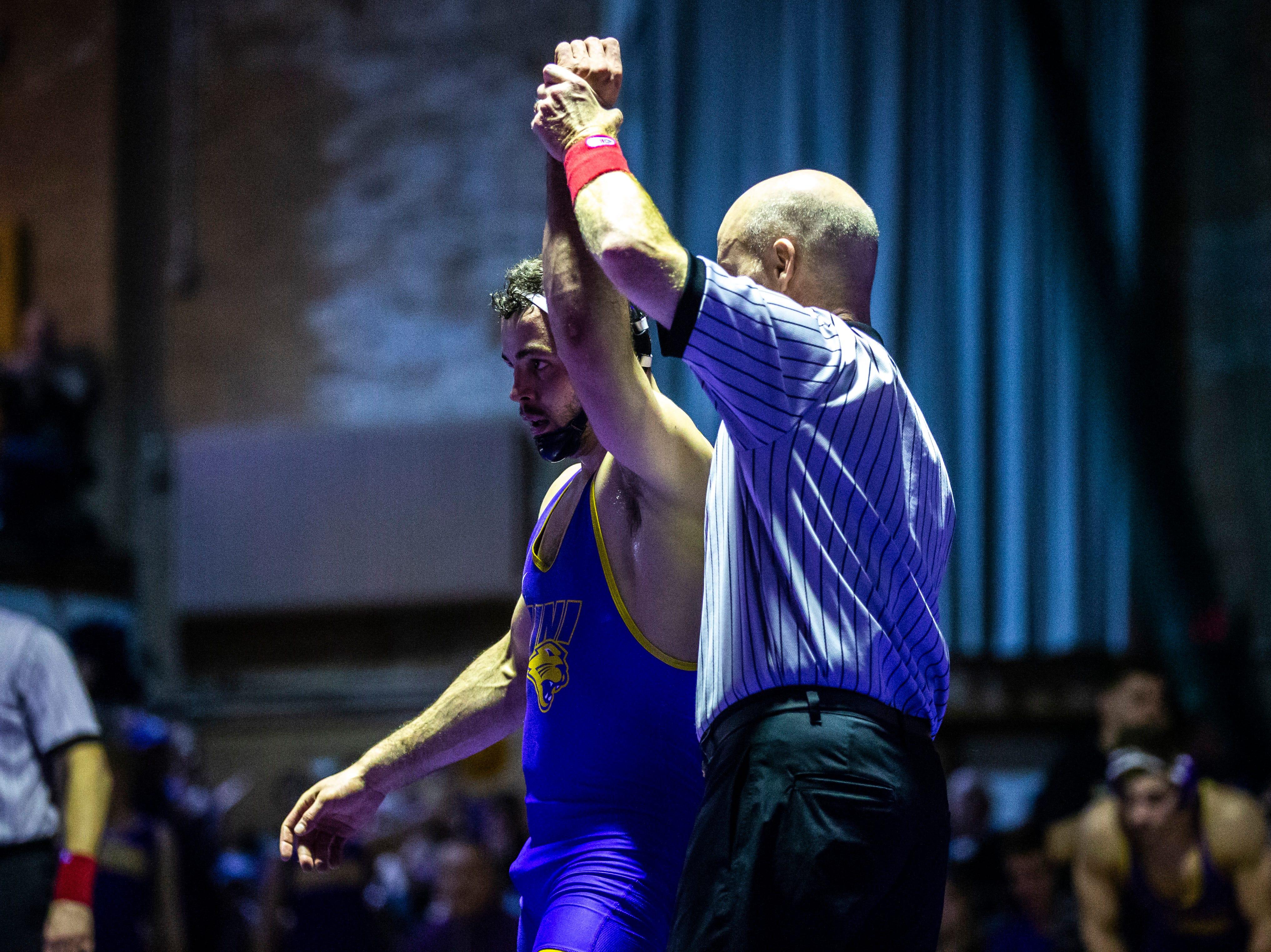 Northern Iowa's Bryce Steiert has his hand raised after wrestling Iowa State's Logan Schumacher at 165 during a NCAA Big 12 wrestling dual on Thursday, Feb. 21, 2019 at the West Gymnasium in Cedar Falls, Iowa.