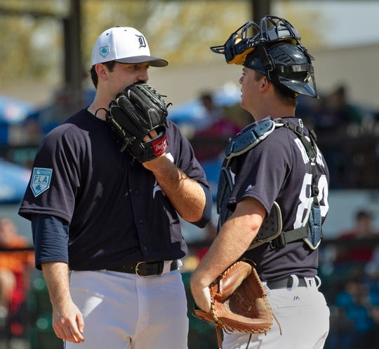 Tigers pitcher Casey Mize talks with catcher Jake Rogers after Mize gave up a run during the fourth inning against Southeastern University at Joker Marchant Stadium in Lakeland, Fla., Feb. 22, 2019.