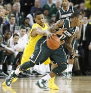 Michigan's Trey Burke steals the ball from Michigan State Keith Appling en route to a breakaway dunk for the final go-ahead basket with less than twenty seconds left on March 3, 2013. The Wolverines won, 58-57, in Ann Arbor.