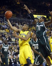 Trey Burke had 20 points in the Wolverines' 60-59 victory over Keith Appling and Michigan State on Jan.17, 2012.