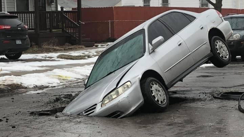 Photos Of Car Stuck In Huge Hamtramck Hole Spread Across Social Media