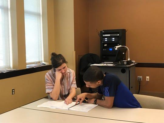 Teacher Katharine Buckley helps a student after class.
