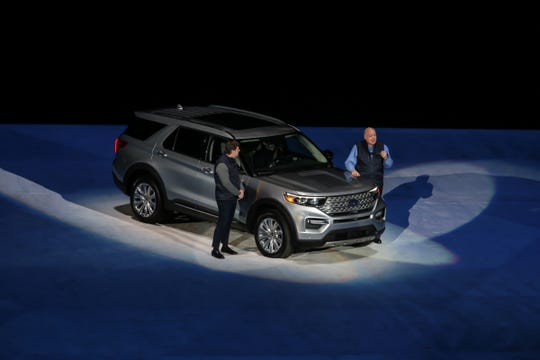 Jim Farley Ford President, Global Markets and Ford Motor Company President and CEO Jim Hackett speak during an unveiling of the all new 2020 Ford Explorer during a Ford event at Ford Field in Detroit on Wednesday, January 9, 2019.