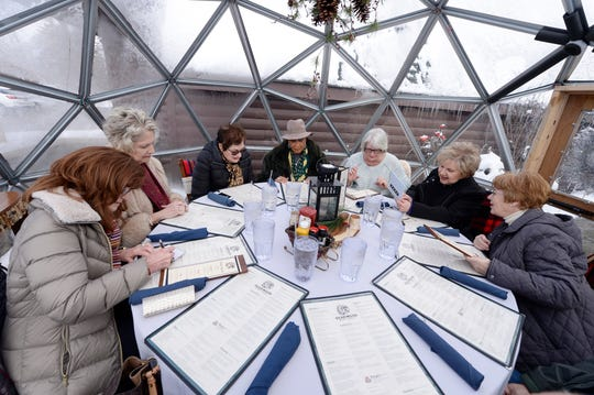 A group of former teachers, from left, Darlene Hazergian of Washington Township, her sister-in-law Carol Hazergian of Washington Township, Marcia Giera of Rochester Hills, Roz Miller of Shelby Township, Sue Allen of Troy, Sheryl Fragomeri and Kathy Reagan of Romeo, enjoy a lunch date together inside one of the outdoor dining igloos at the Deadwood Bar and Grill in Northville.