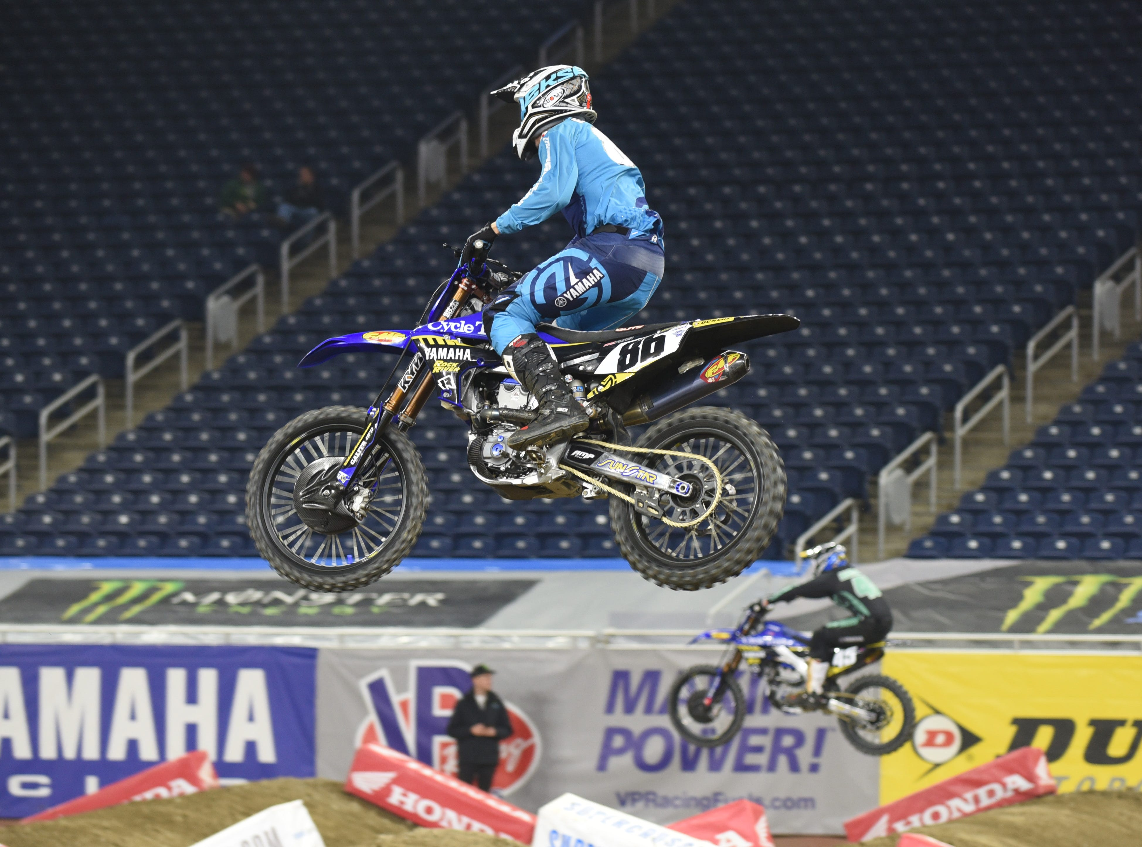 Top Supercross rider Ryan Breece (86) leaps by fellow riders during a practice.