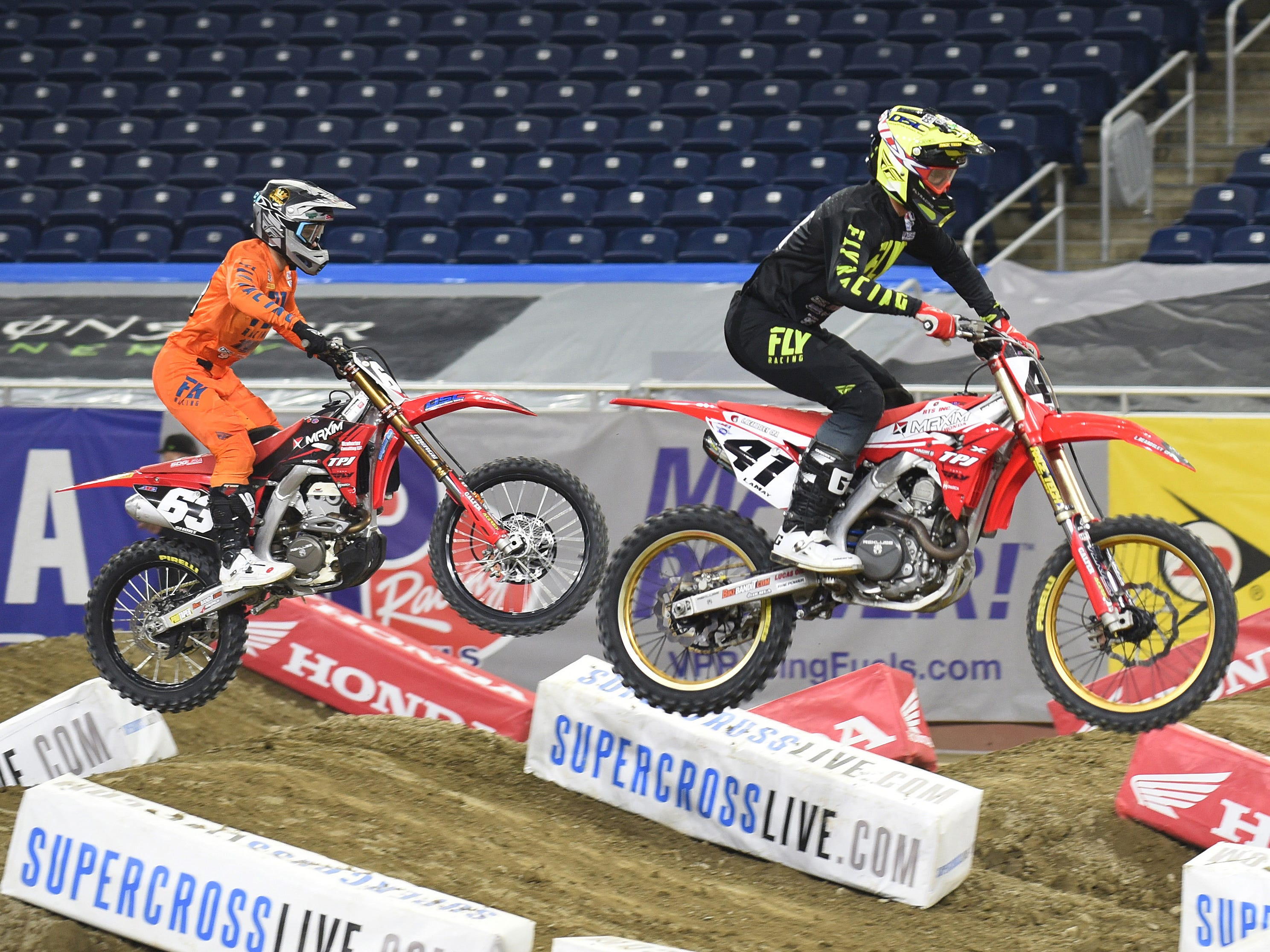 Top Supercross riders John Short (left) and Ben Lamay take to the track during a practice run for the 2019 Monster Energy Supercross at Ford Field in Detroit on Friday, February 22, 2019.