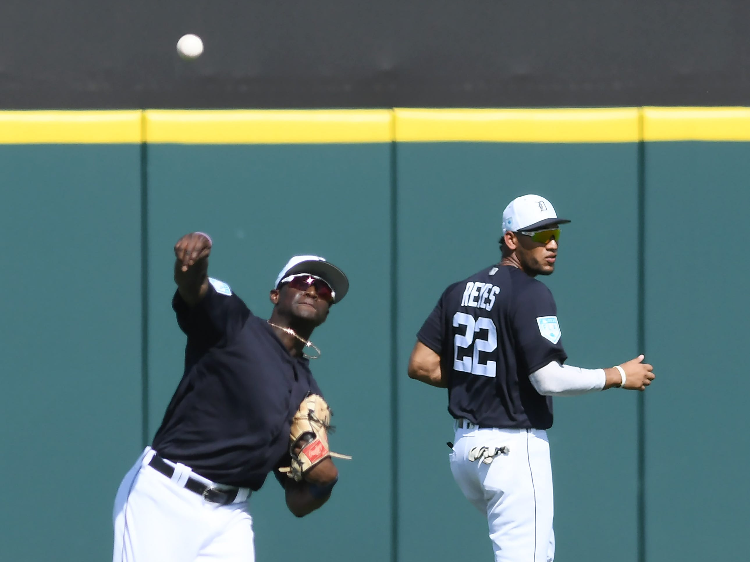 Next to right fielder Victor Reyes (22), Tigers non-roster invitee outfielder Daz Cameron throws the ball in after a hit in the fourth inning.