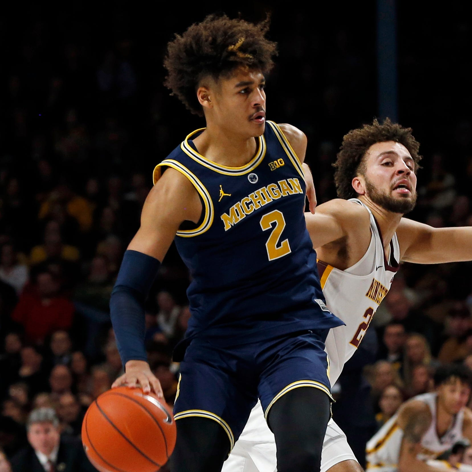 In 'tournament' mode, Michigan handles Minnesota as MSU clash looms