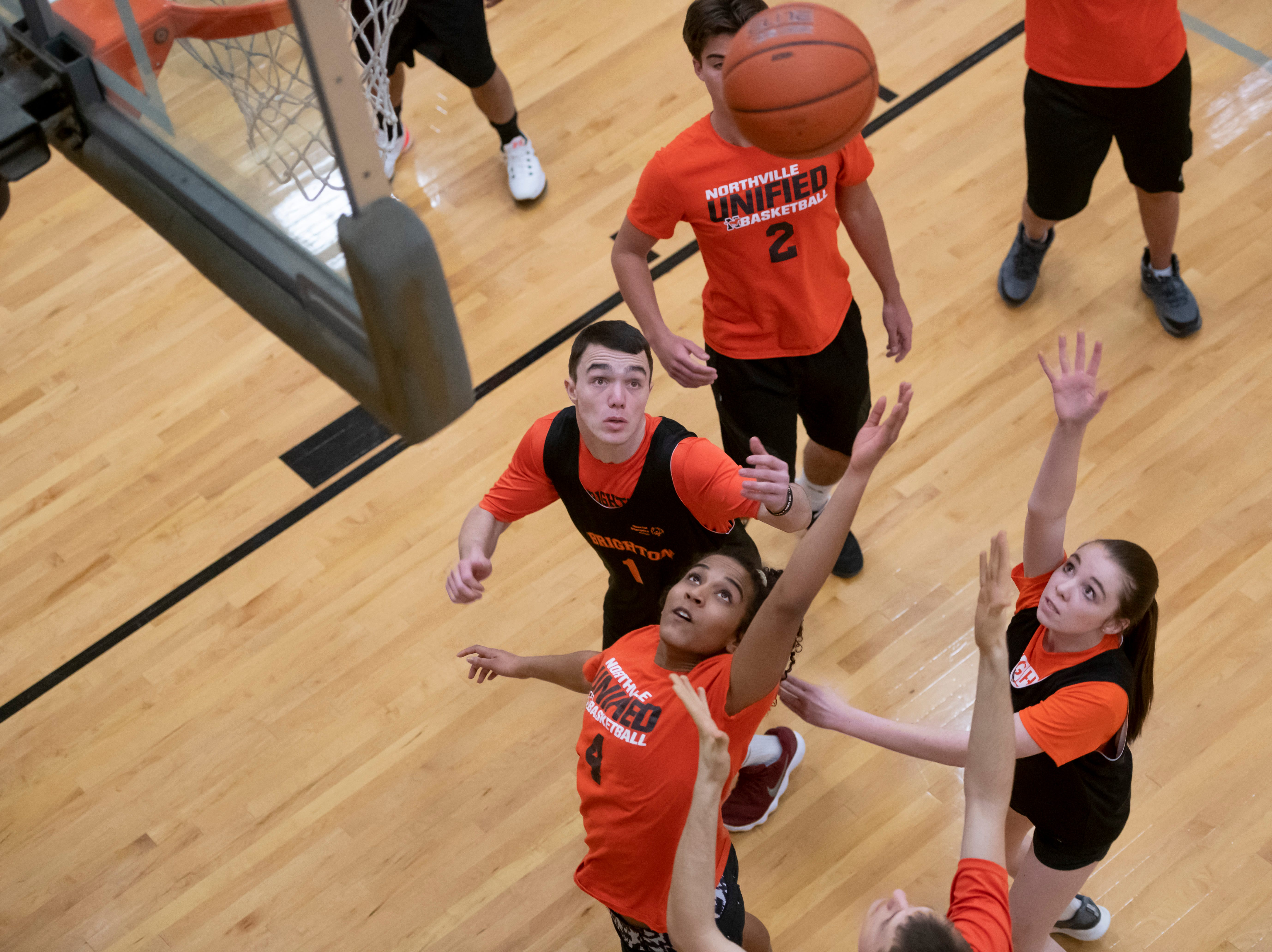 Northville Unified and Brighton battle for a rebound during the Kensington Lakes Athletic Association Unified basketball tournament at Novi high school.