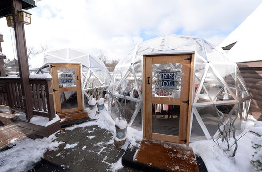 The Llama Lounge, left, and the Grey Wolf outdoor dining igloos offer a unique winter dining experience for customers of the Deadwood Bar and Grill in Northville.
