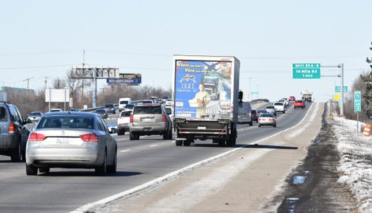 Motorists travel northbound along I-75 at 14 Mile in Troy. Drivers would get to choose their level of personal injury medical protection under competing Michigan House and Senate no-fault auto insurance reform plans.