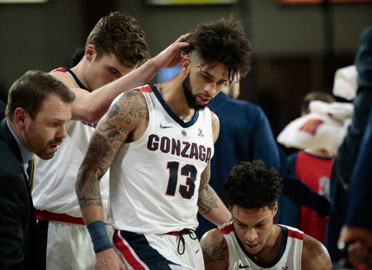 Josh Perkins of the Gonzaga Bulldogs is congatulated on breaking Gonzaga's all-time assist record with 669.