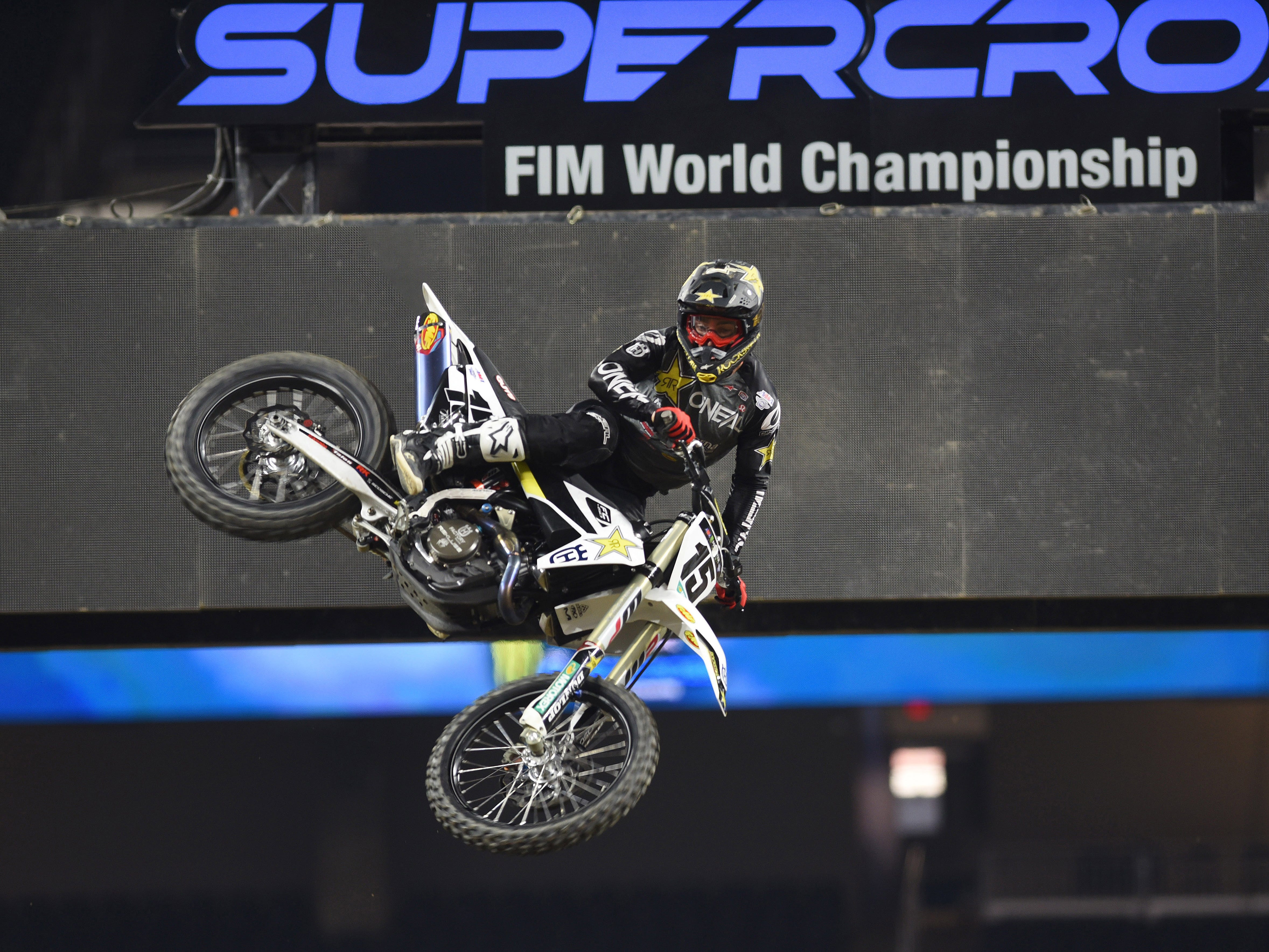 Top Supercross rider Dean Wilson (15) makes a statement as he flips his back wheel over a dirt mound for the 2019 Monster Energy Supercross at Ford Field in Detroit on Friday, February 22, 2019.