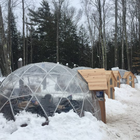 At Hop Lot micro-brewery In Suttons Bay customers stay warm while sipping cold suds in the winter time. Hop Lot's management  installed igloos last winter to accommodate the continued crowds at its popular brewery.