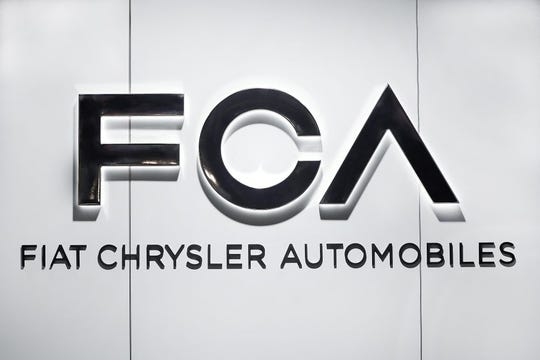 In this Monday, Jan. 14, 2019 file photo, Fiat Chrysler Automobiles FCA logo is shown at the North American International Auto Show in Detroit.