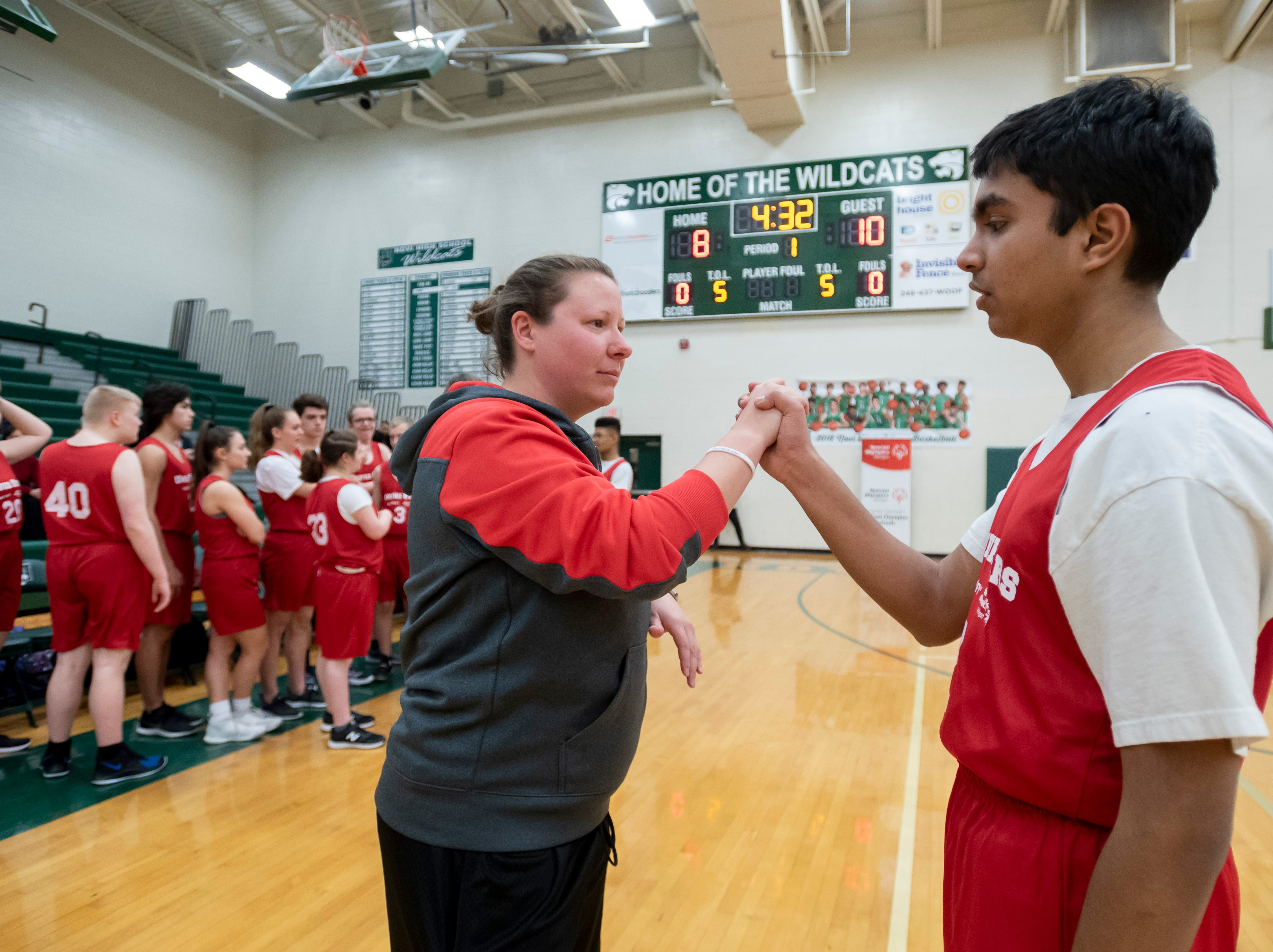 Plymouth-Canton coach Merrill DeRose gives words of encouragement to Chiraag Krishnan.